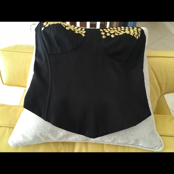 Black Bustier with gold stars accented on the top!